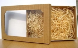 Gift box with a transparent lid and filling (wood wool)